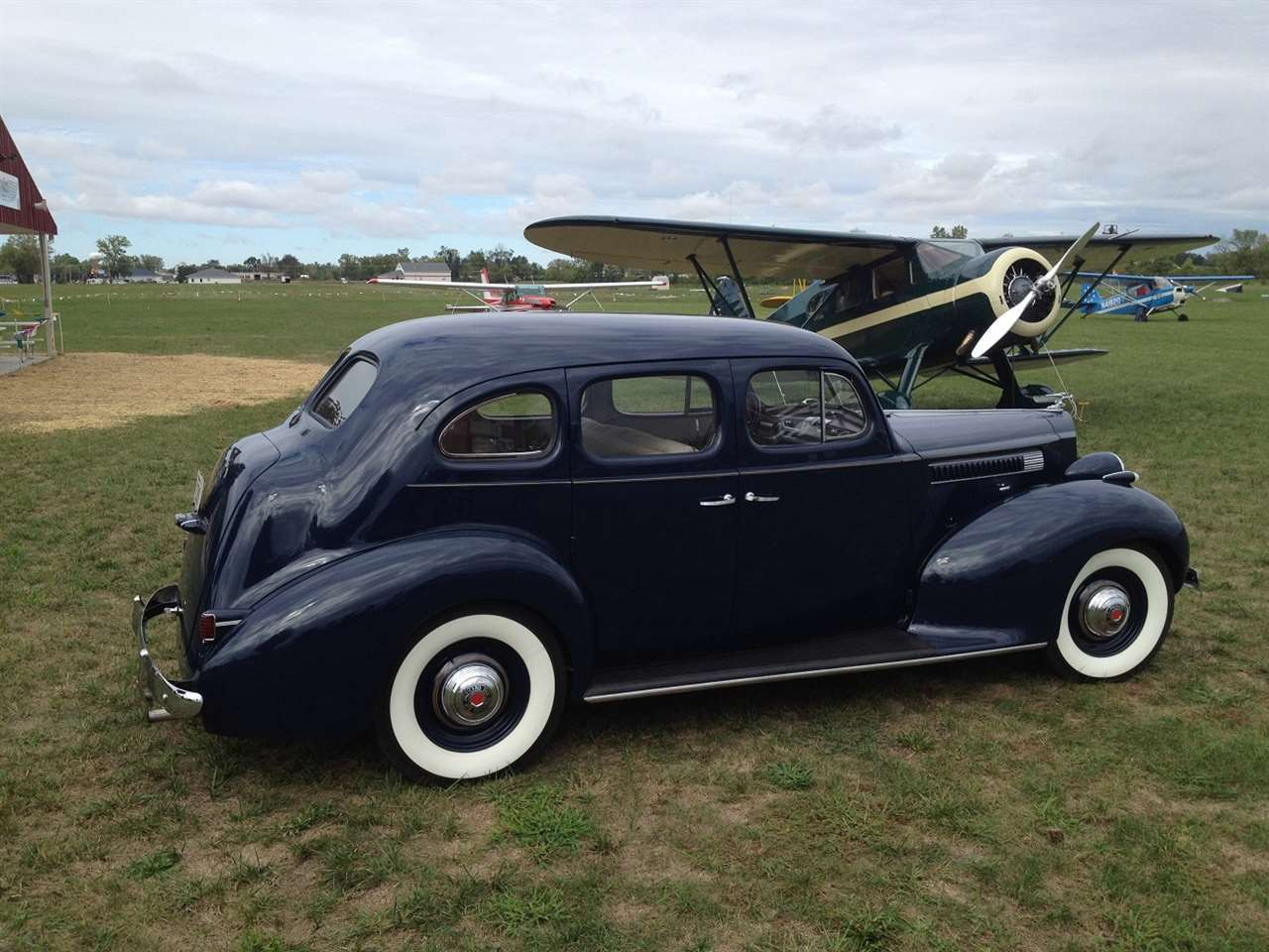 39 Packard Six with Waco Plane