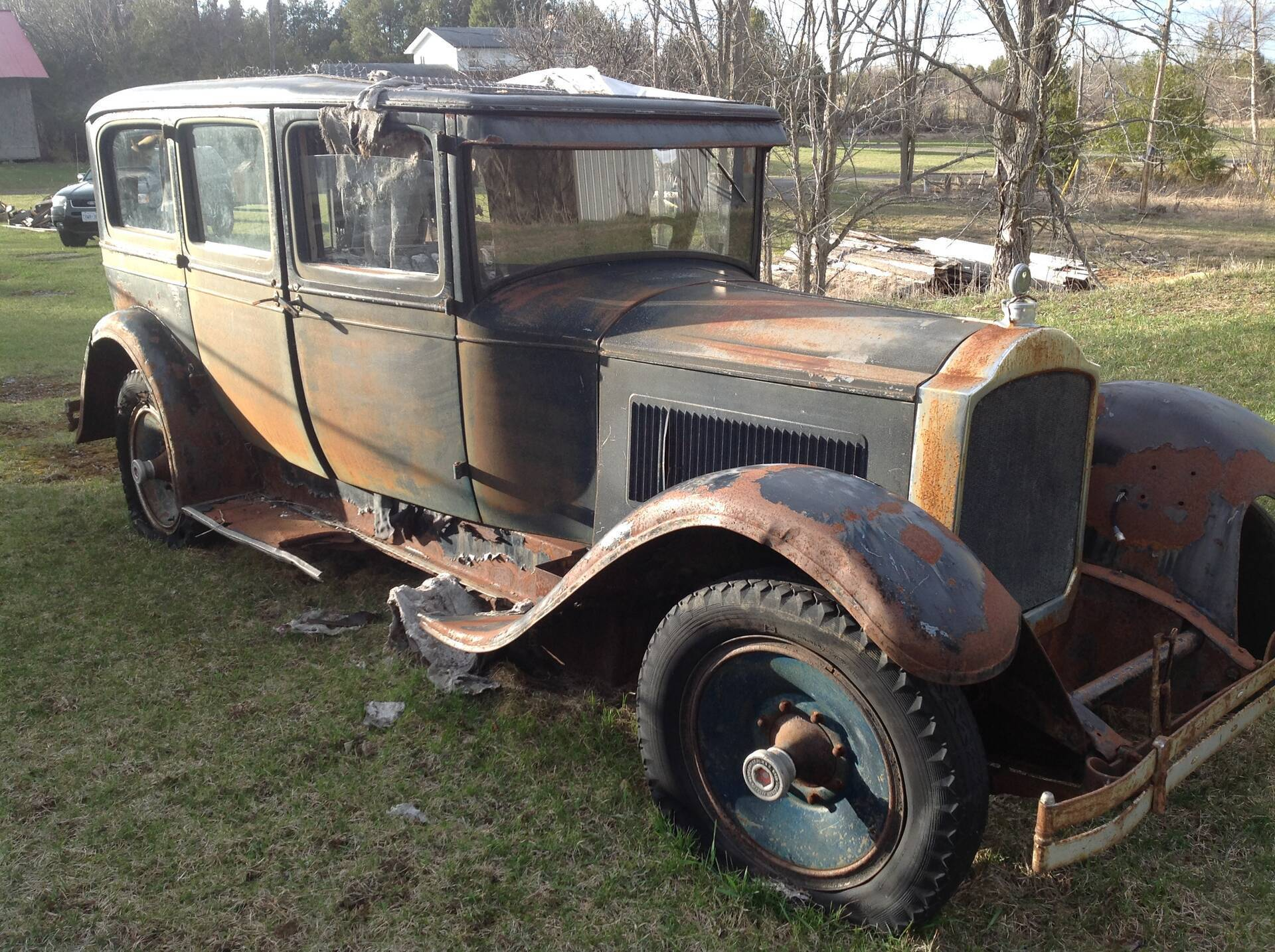 1920's Packard in a field .