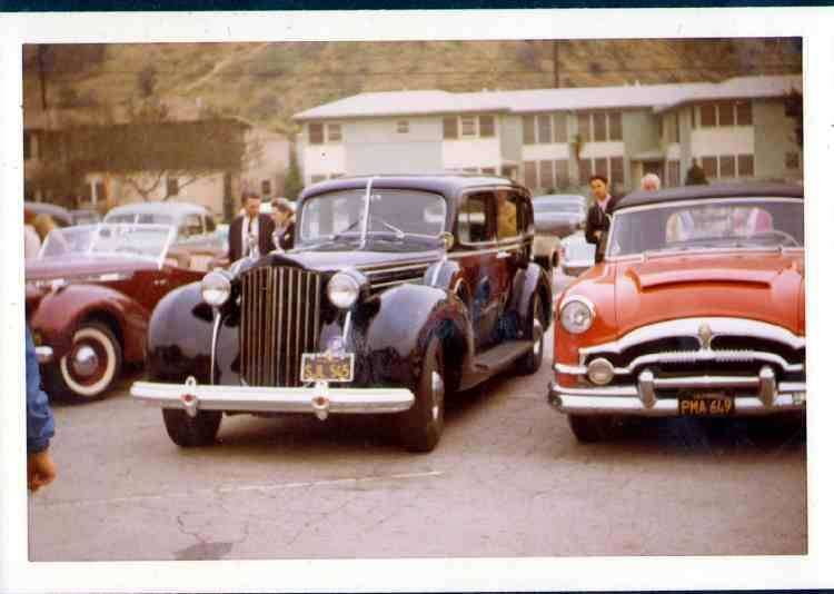"1939 Touring Sedan parked next to the 1953 Caribbean ""The Scarlet Lady"""