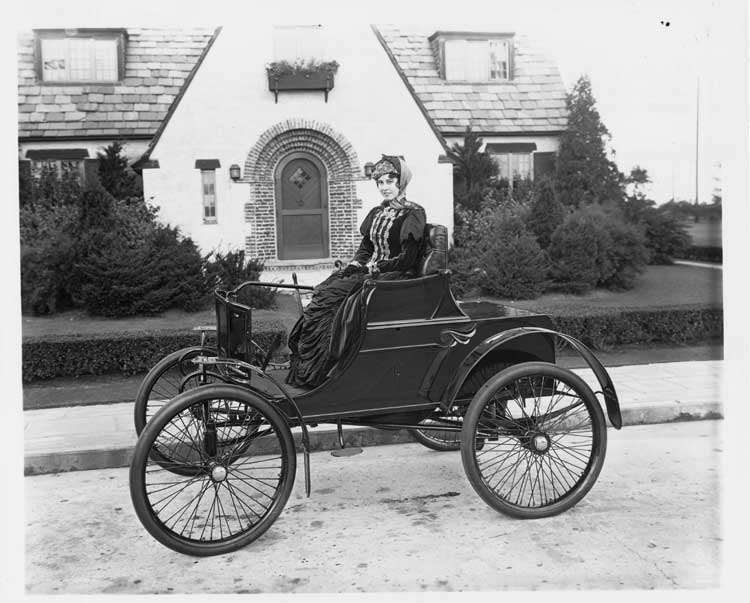 Packard Model A with woman in front of the Lodge