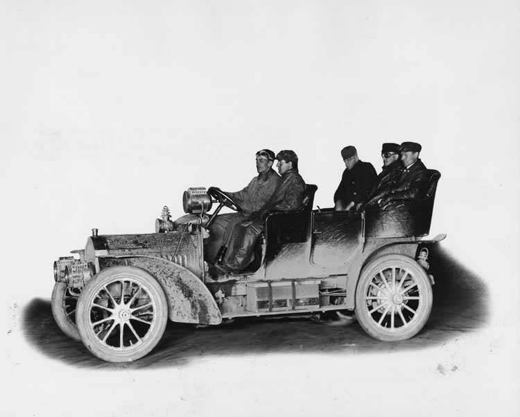 1905 Packard Model N touring car with driver and four male passengers