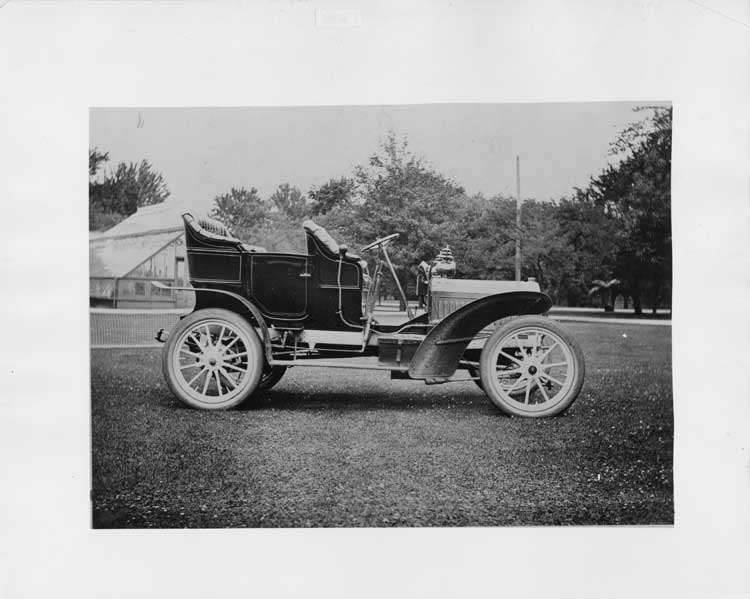 1905 Packard Model N, right side view with greenhouse in background