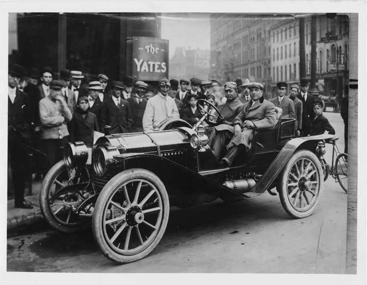 1908 Packard 30 Model UA with driver Barney Oldfield and C. Arthur Benjamin