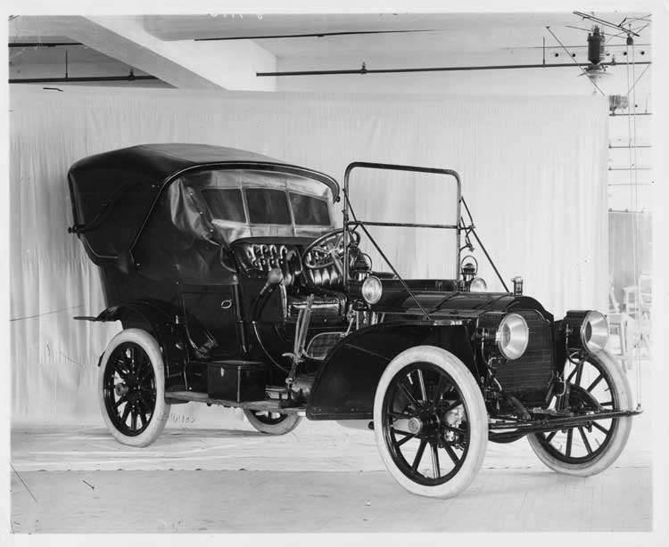 1908 Packard 30 Model UA touring car on photo backdrop