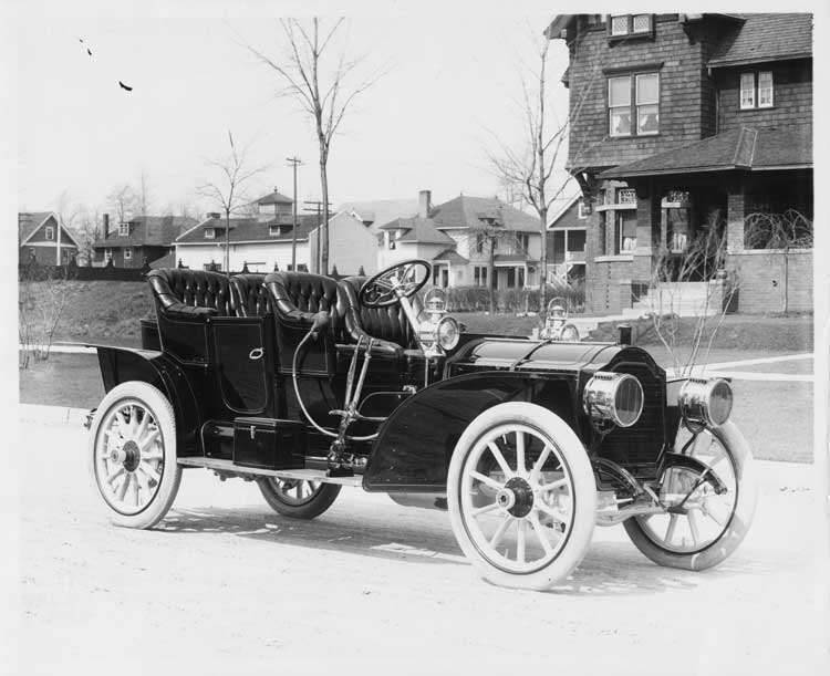 1908 Packard 30 Model UA close-coupled with rumble seat parked on residential street