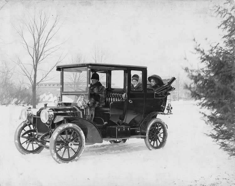 1909 Packard 18 Model NA landaulet, in winter with male driver, & two female passengers