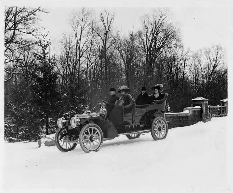 1909 Packard 30 Model UB touring car, with two couples on winter road
