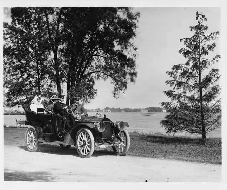 1909 Packard 30 Model UB touring car on Belle Isle with four passengers