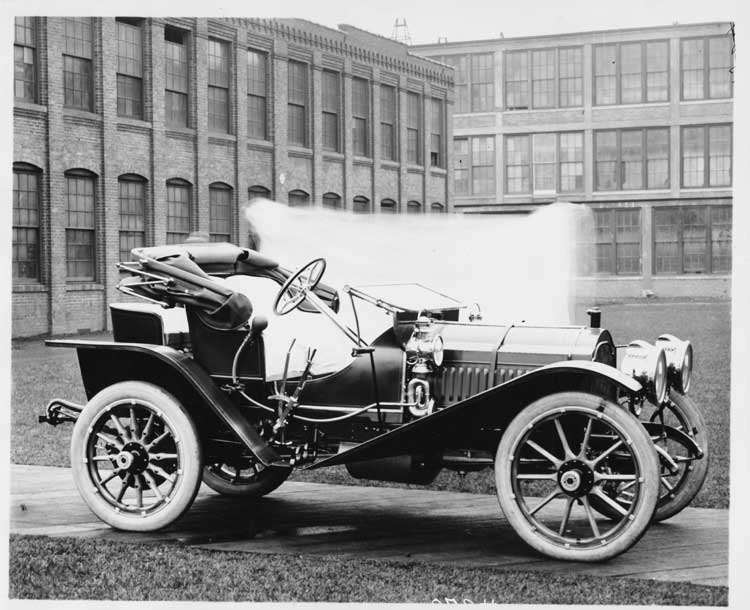 1909 Packard 30 Model UBS runabout, right side, factory buildings in background