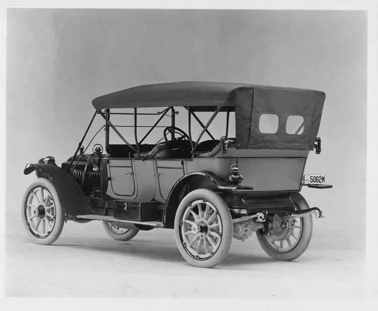 1911 Packard 30 Model UD phaeton, three-quarter rear view, left side, with top raised