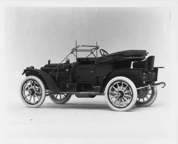 1911 Packard 30 Model UDS runabout, three-quarter rear view, left side, top lowered
