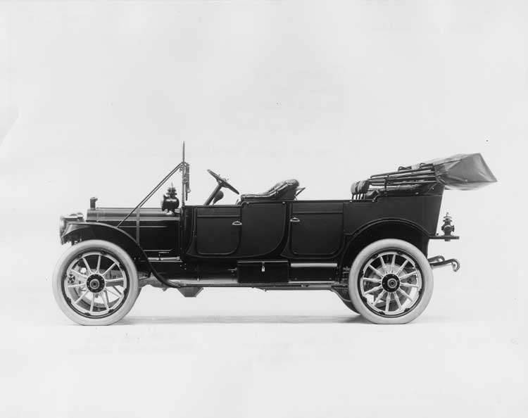 1912 Packard 30 Model UE touring car, left side view, top lowered
