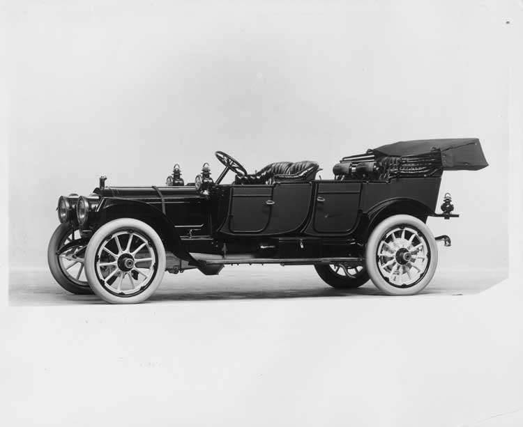 1912 Packard 6 touring car, left side view, top lowered