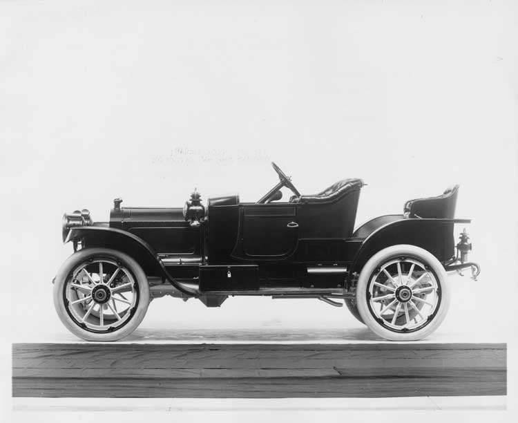 1912 Packard 18 Model NE runabout, left side, no top, with rumble seat