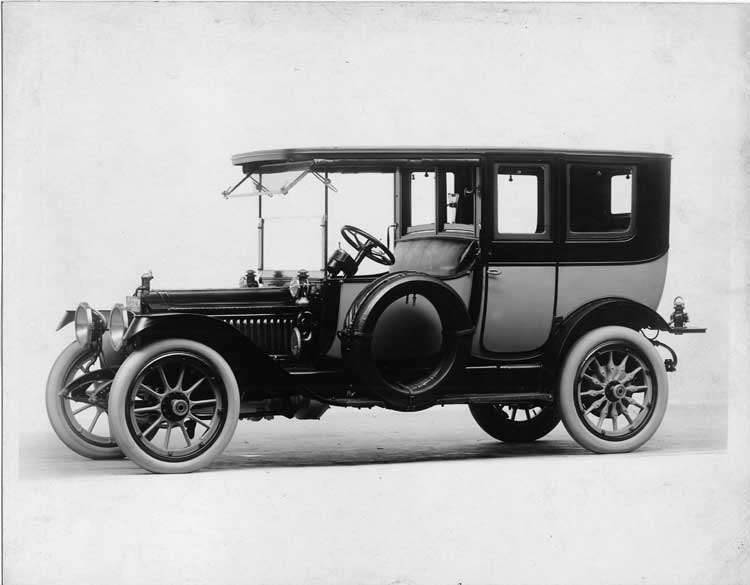 1913 Packard 38 two-toned limousine, left side, with two spare tires shown covered