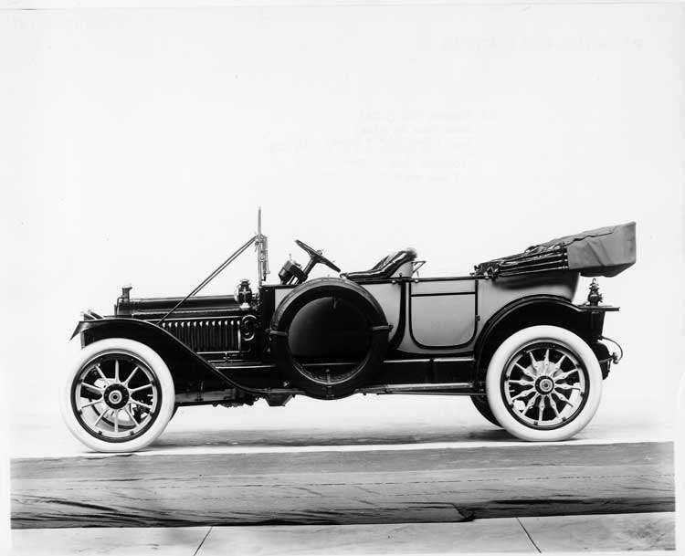 1913 Packard 38 two-toned touring car, left side, top folded