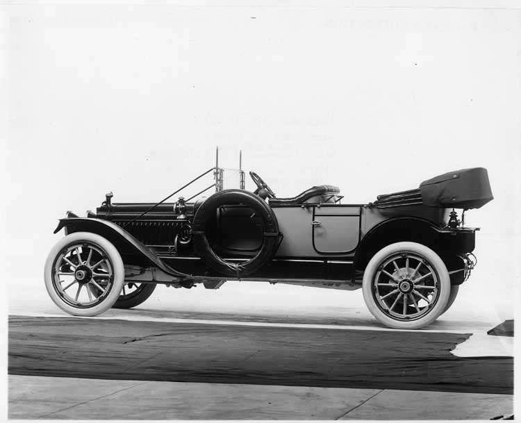 1913 Packard 38 phaeton, five-sixth rear view, left side, top folded