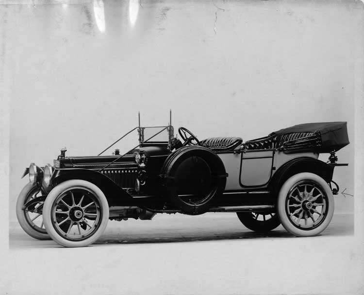 1913 Packard 38 phaeton, five-sixth front view, left side, top folded