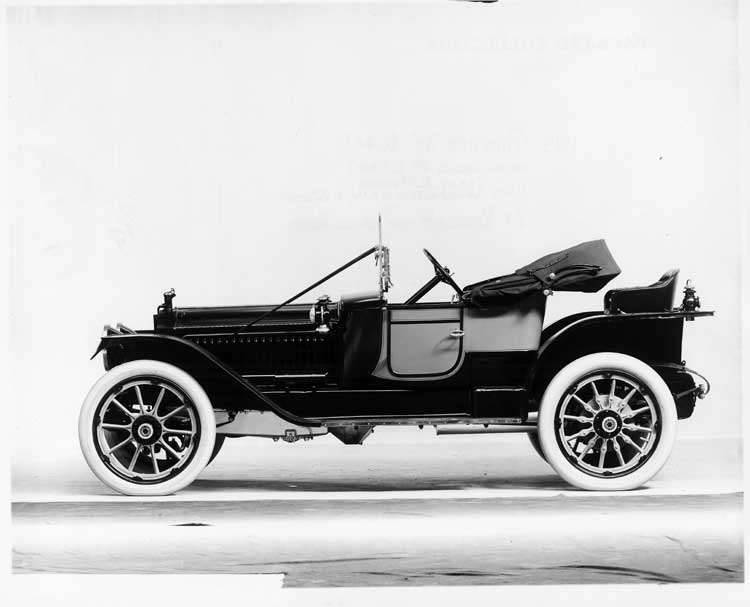 1913 Packard 48 two-toned runabout, left side, top folded