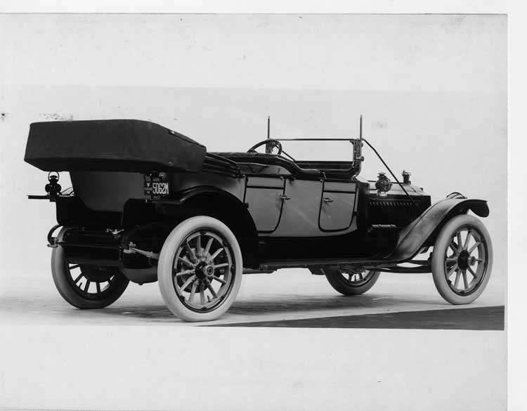 1913 Packard 38 two-toned phaeton, three-quarter rear view, right side, top folded