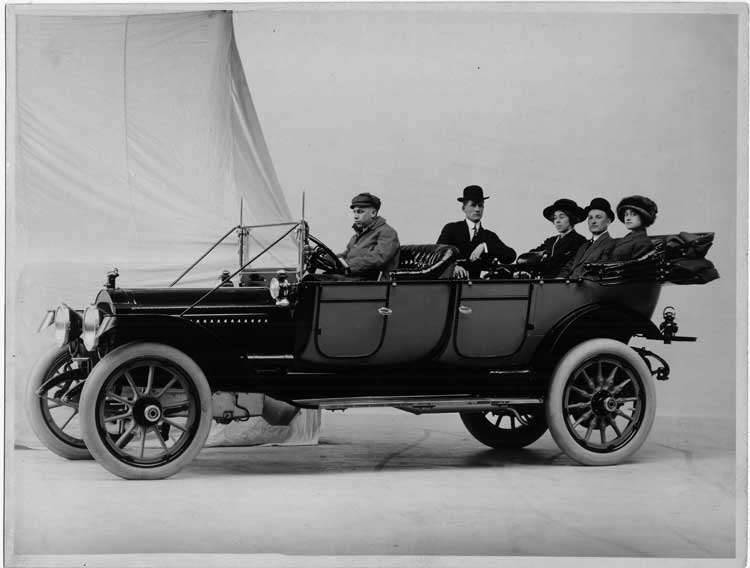 1913 Packard 48 touring car, male driver, male and female passengers