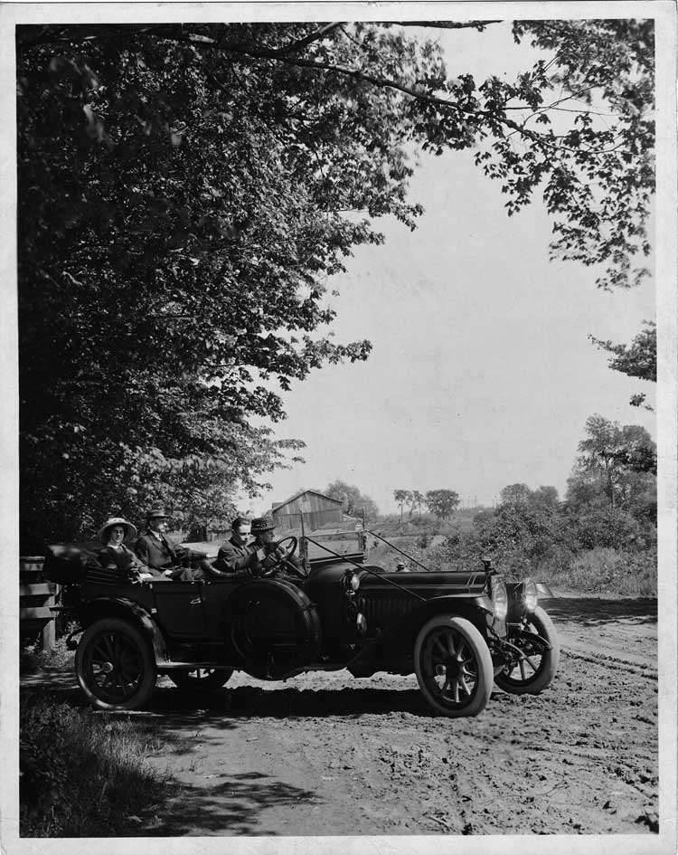 1913 Packard 48 phaeton, turning out of drive, barn in background
