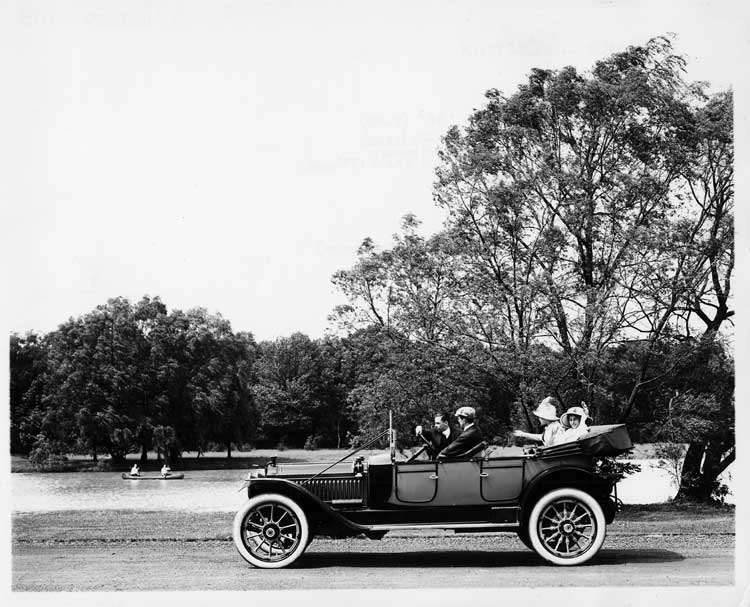 1913 Packard 48 phaeton, male driver, male and female passengers, on Belle Isle