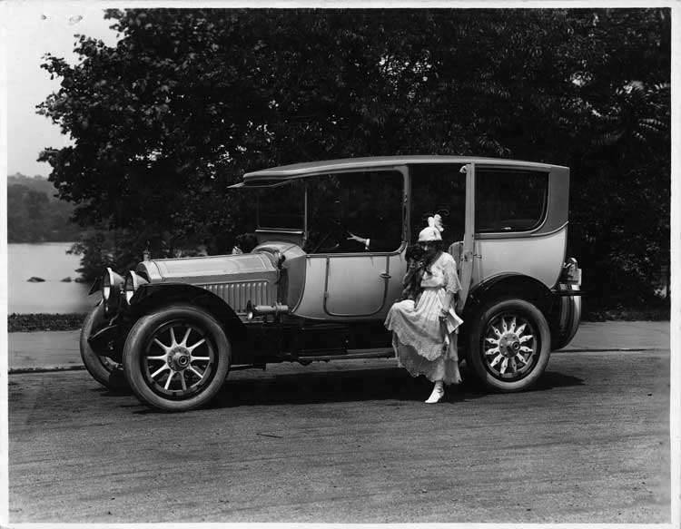 1916 Packard 1-25 two-toned limousine, Anna Held and her dog stepping into rear