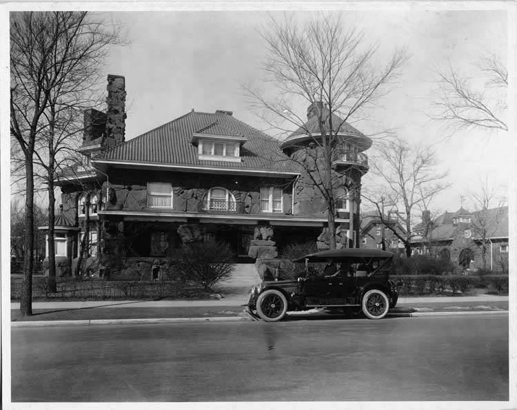 1916 Packard 1-35 touring car, with male driver, parked in front of a residence in Chicago, Ill.