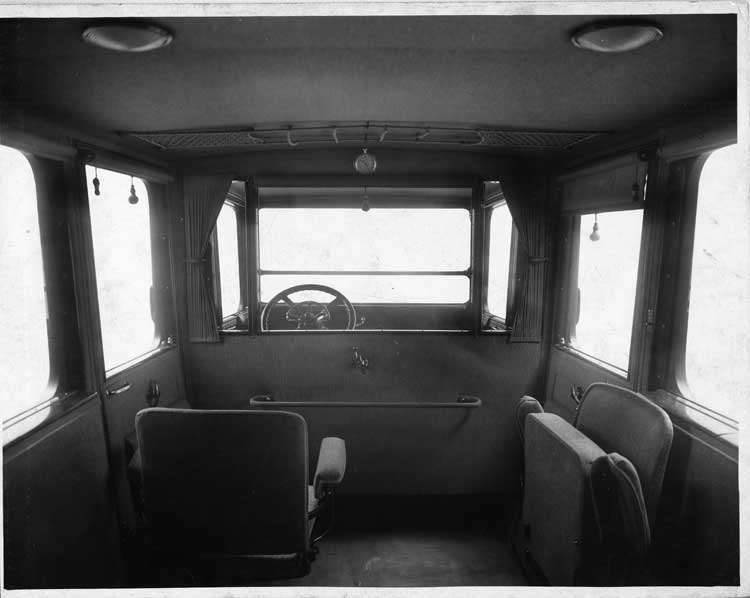 1917 Packard imperial limousine, view of interior from rear seat, shown with side auxiliary seats