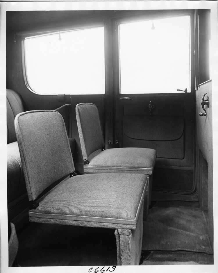 1917 Packard limousine, view of rear interior from side door, showing side-folding auxiliary seats