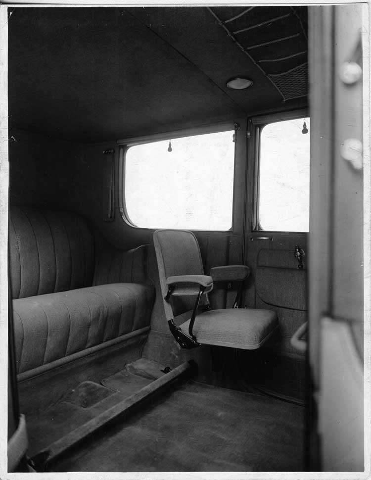 1917 Packard landaulet, view of rear interior from right side door, showing side-folding auxiliary s