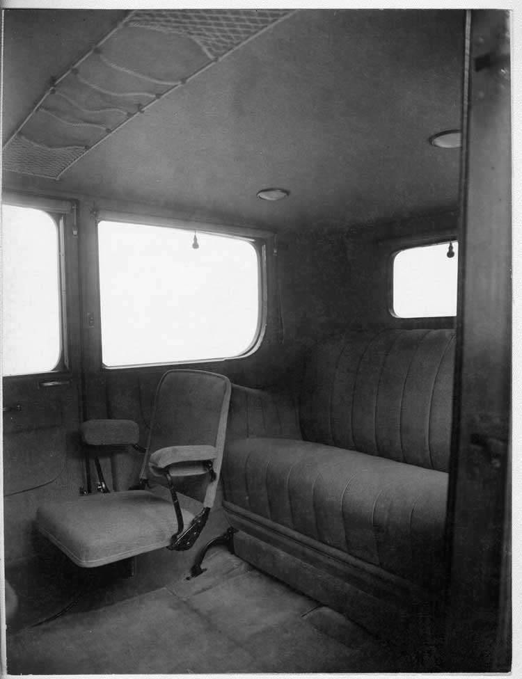 1917 Packard cab side limousine, view of rear interior from left side door, showing side-folding aux