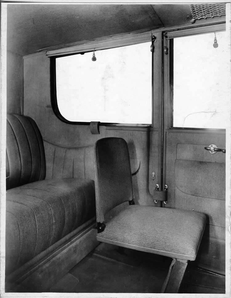 1917 Packard landaulet, view of rear interior from left side door, showing side-folding auxiliary se