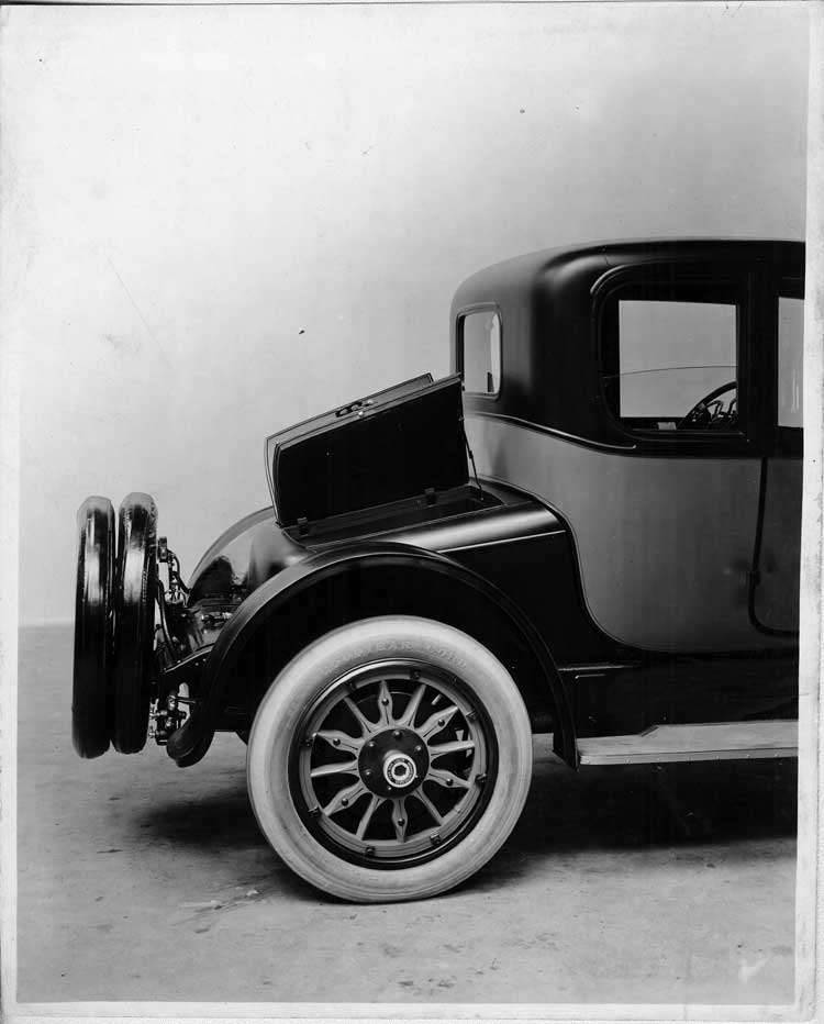 1917 Packard two-toned coupe, side rear view, compartment door opened