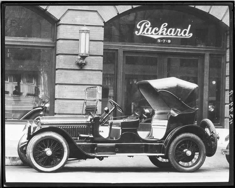 1917 Packard special victoria, parked on street in front of Packard dealership