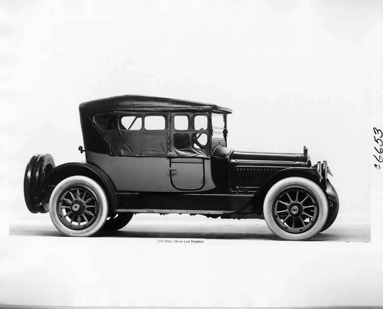 1917 Packard two-toned cloverleaf runabout, top raised, side curtains in place, right side view