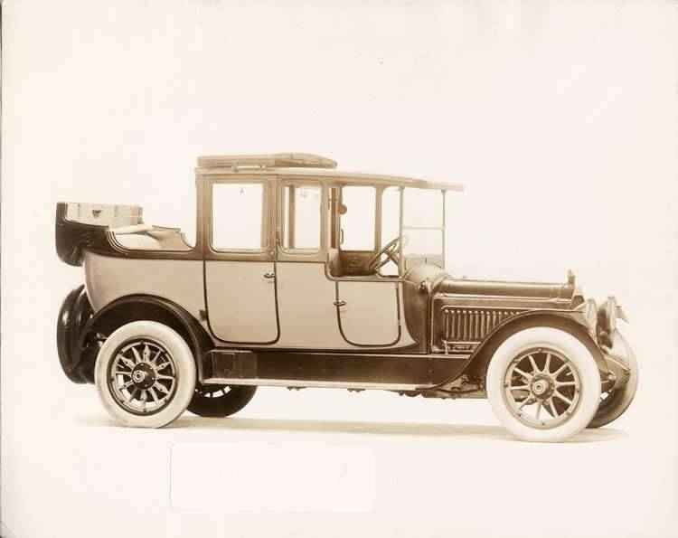 1917 Packard cab side two-toned landaulet, back quarter collapsed, three-quarter right front view