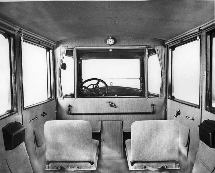 1918 Packard imperial limousine, view of interior from back seat, side-folding auxiliary seats visib