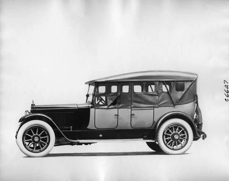 1918 Packard two-toned touring car, left side view, top raised, side curtains in place