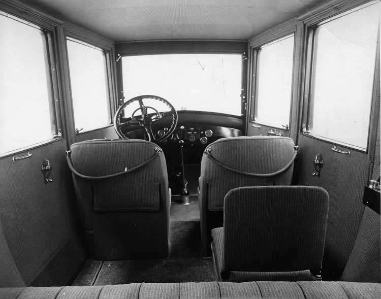 1918-1919 Packard brougham, view of interior showing right, forward-folding auxiliary seat