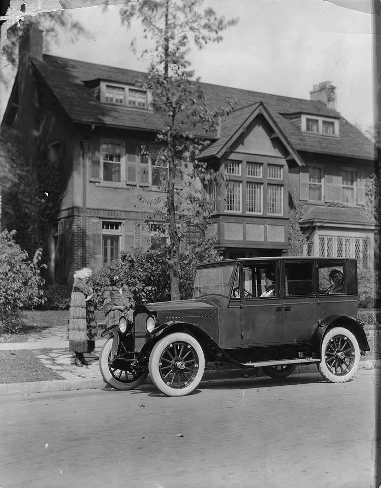 1921-1922 Packard sedan, parked on street in front of home