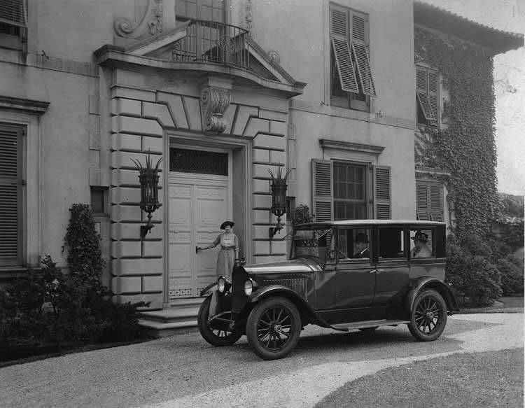 1921-1922 Packard sedan, parked on driveway in front of stone residence
