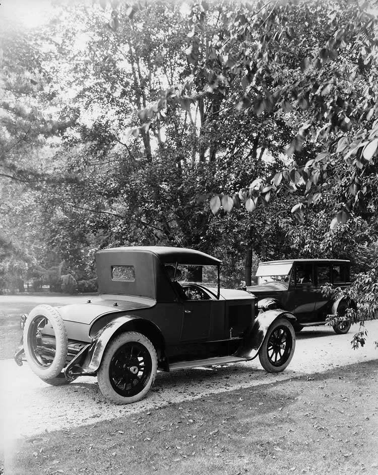 1921-1922 Packard sedan and runabout, pictured passing on country road