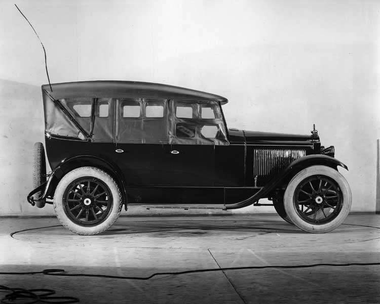 1922 Packard touring car, right side view, top raised, storm curtains in place