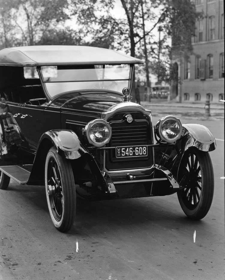 1922 Packard touring car, two-thirds front view, parked on street