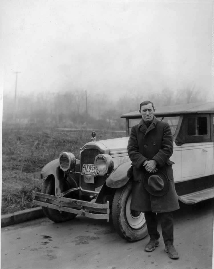 1922-1923 Packard touring car used as Detroit jitney, with driver