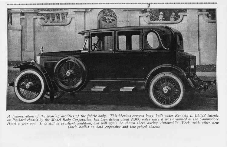 1922-1923 Packard experimental sedan, left side view, parked on street, cloth-covered roof
