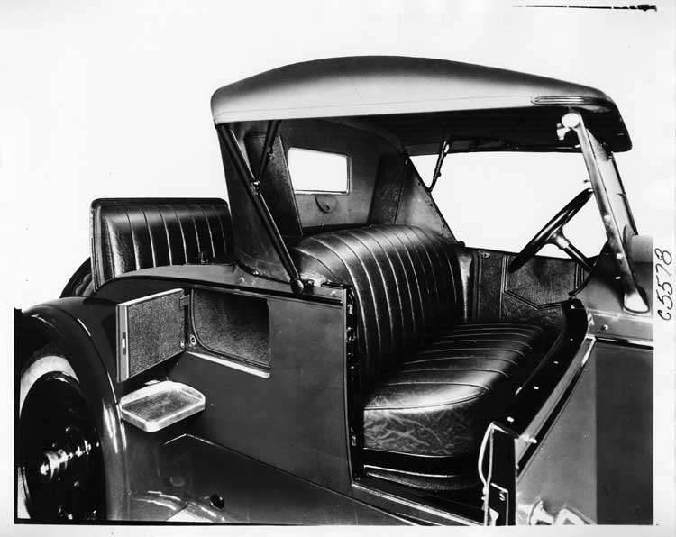1924 Packard runabout interior right side, top raised, small rear compartment door open