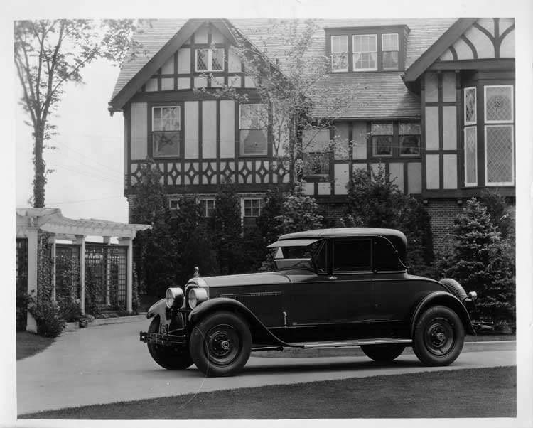 1925 Packard coupe, seven-eights left front view, parked in front of large home